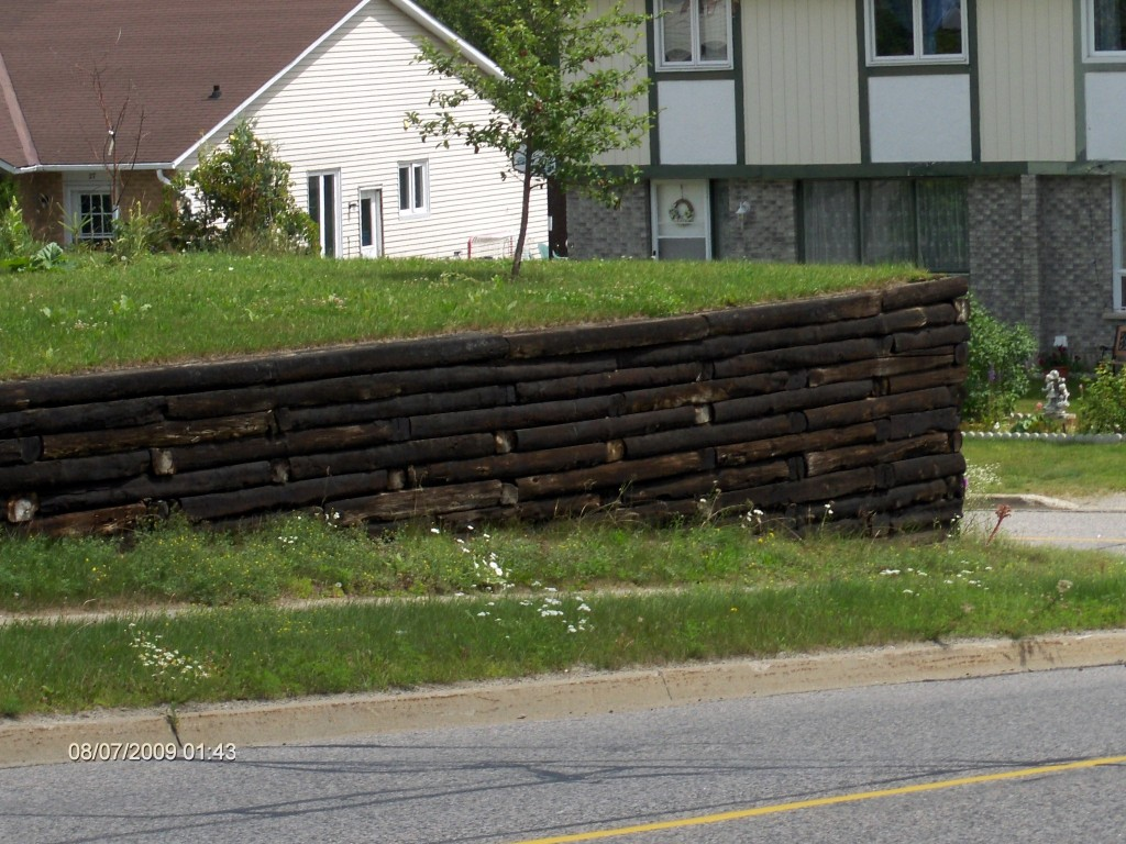 Is this Railroad Tie Retaining Wall  Too High?