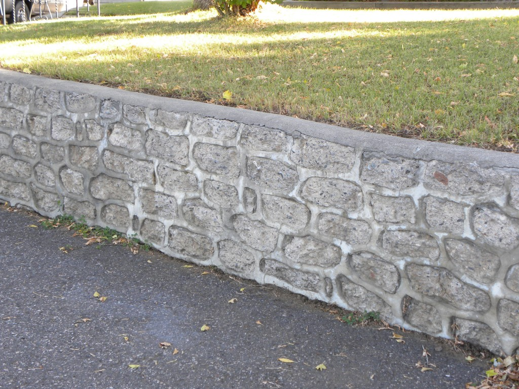concrete rubble block retaining wall note the cap - Cinder Block Wall Design