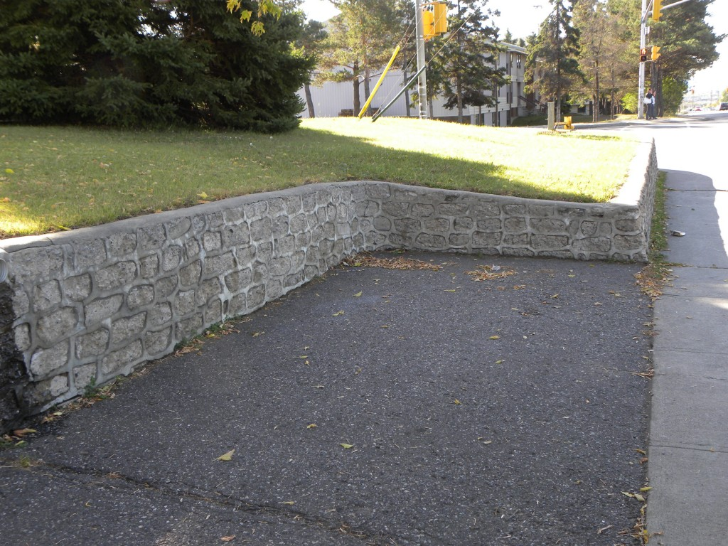 a very old concrete block retaining wall note the cap - Cinder Block Wall Design