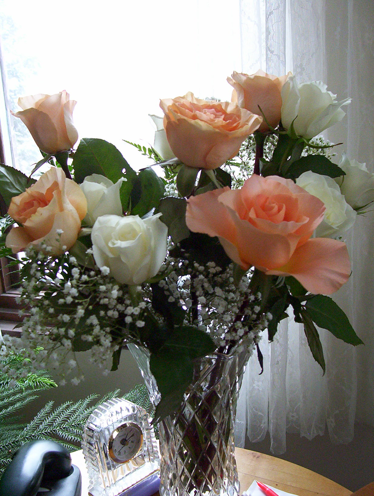 A glass vase with beautiful salmon -coloured roses