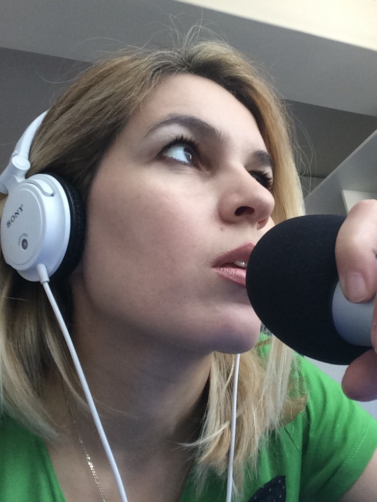 Ani Alexander recording a podcast