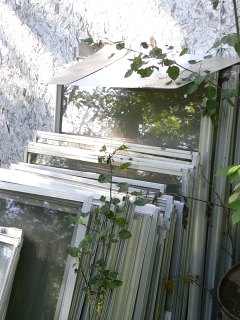 Windows with aluminum frames stored for recycling